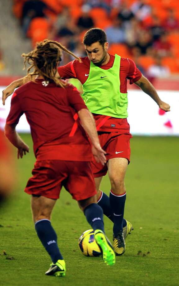 The Houston Dynamo's Will Bruin, plays against national team teammate Kyle Beckerman during a scrimmage as the U.S. Mens National Soccer Team held an open practice session at BBVA Compass Stadium. Photo: Johnny Hanson, Houston Chronicle / © 2013  Houston Chronicle
