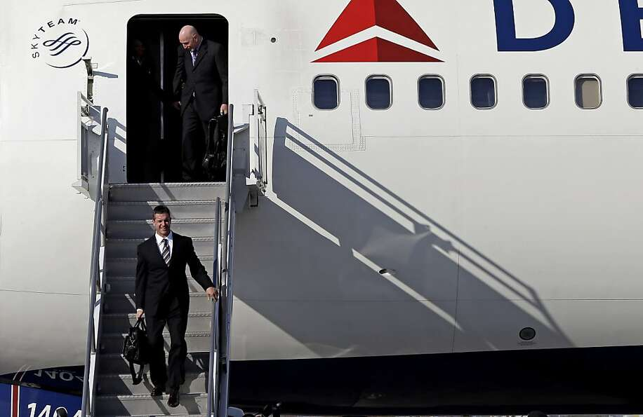 Head coach John Harbaugh led the Ravens off their charter in New Orleans, hours after he told Baltim