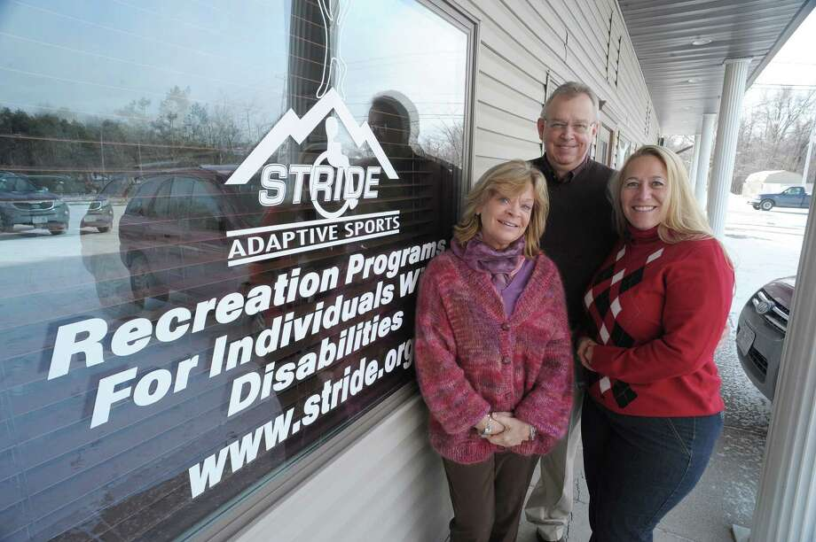 Mary Ellen Whitney, left, executive director, Mark Moran, center, program director, and Kristen Kelley, development director, pose outside the offices of STRIDE Adaptive Sports on Wednesday, Jan. 23, 2013 in Rensselaer, NY.  The organization is a nonprofit that provides sports and recreation lessons and opportunities to kids with disabilities and local wounded warriors. All lessons are taught by trained and skilled volunteers. With only a staff of three, the organization provides more than 7,000 lessons per year ? all by volunteers.  (Paul Buckowski / Times Union) Photo: Paul Buckowski  / 00020853A