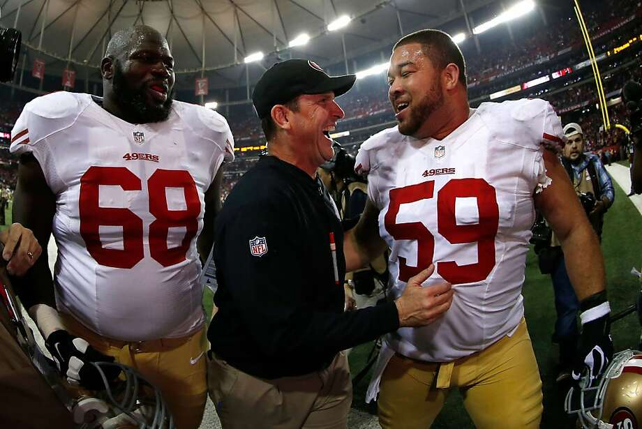 Offensive linemen Leonard Davis (No. 68) and Jonathan Goodwin enjoy that championship feeling with Jim Harbaugh. Photo: Chris Graythen, Getty Images