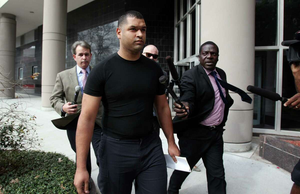 Emerson Canizales, 26, of Kingwood, leaves the federal courthouse Monday after he and Michael Miceli appeared at a brief hearing.