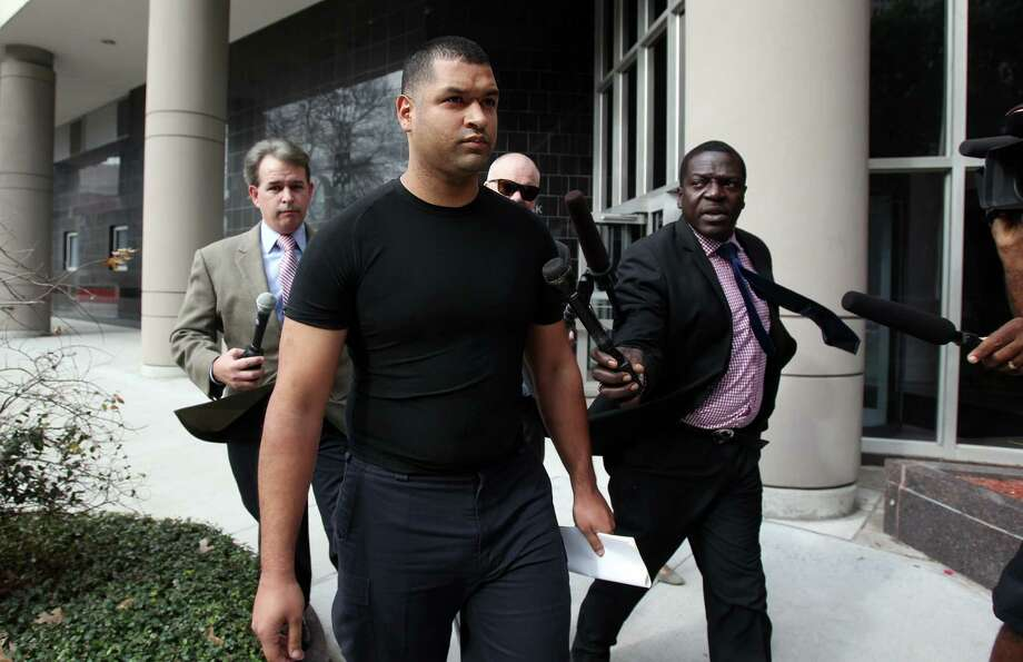 Emerson Canizales, 26, of Kingwood, leaves the federal courthouse Monday after he and Michael Miceli appeared at a brief hearing. Photo: Mayra Beltran, Staff / © 2013 Houston Chronicle