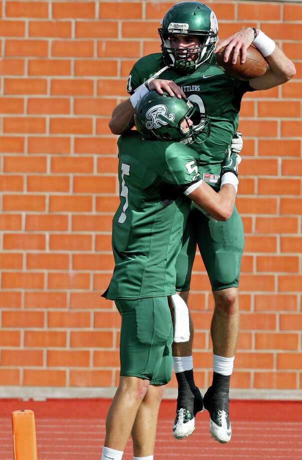 FOR SPORTS - Reagan's Trevor Knight (right) celebrates with teammate Reagan's Austin Hays after scoring a touchdown against O'Connor during first half action of their Class 5A Division II playoff game Saturday Nov. 19, 2011 at Heroes Stadium. Photo: EDWARD A. ORNELAS, Express-News / © SAN ANTONIO EXPRESS-NEWS (NFS)