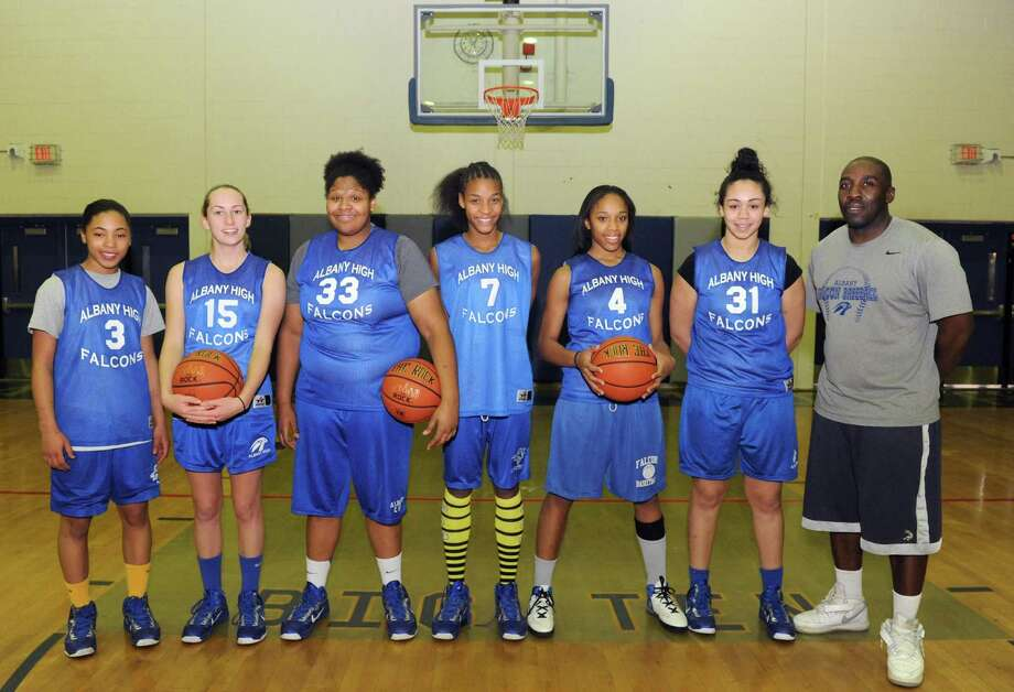Albany High School girl's basketball starters, left to right Ayanna Hunter,Cara Waterson, Melissa Canty, Mylah Chandler, Emia Willingham Hurst, Ariel Greer and head coach Decky Lawson on Thursday Jan. 24,2013 in Albany, N.Y. (Michael P. Farrell/Times Union) Photo: Michael P. Farrell