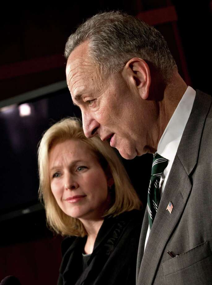 Sen. Charles Schumer, D-N.Y., right, and Sen. Kirsten Gillibrand, D-N.Y., left, react after the Senate passed a $50.5 billion emergency relief measure for Superstorm Sandy victims at the Capitol in Washington, Monday, Jan. 28, 2013. Three months after Superstorm Sandy devastated coastal areas in much of the Northeast, the Senate is finaly sending a $50.5 billion emergency package of relief and recovery aid to President Obama for his signature. (AP Photo/J. Scott Applewhite) Photo: J. Scott Applewhite