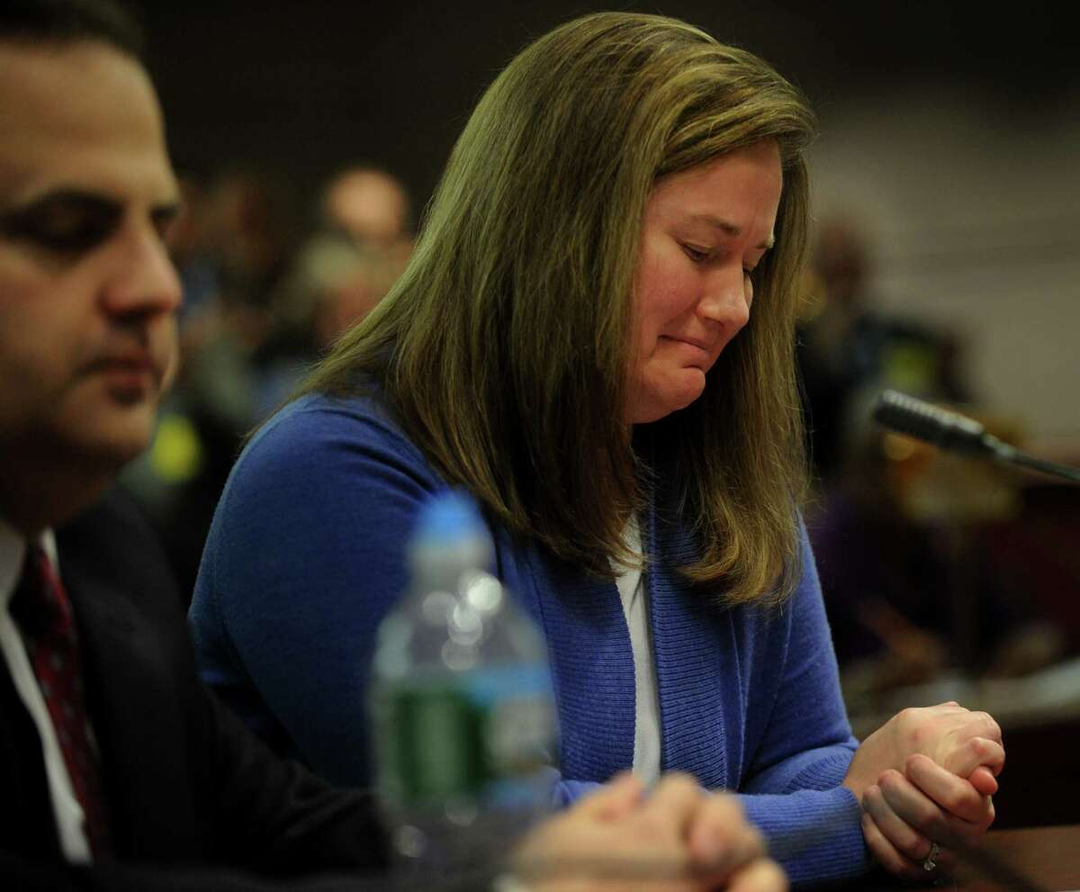 Mark and Cindy Mattioli, of Newtown, parents of James Mattioli, one of the children killed in the Sandy Hook School shooting, testify before the Gun Violence Prevention Working Group at the Legislative Office Building in Hartford, Conn. on Monday, January 28, 2013.