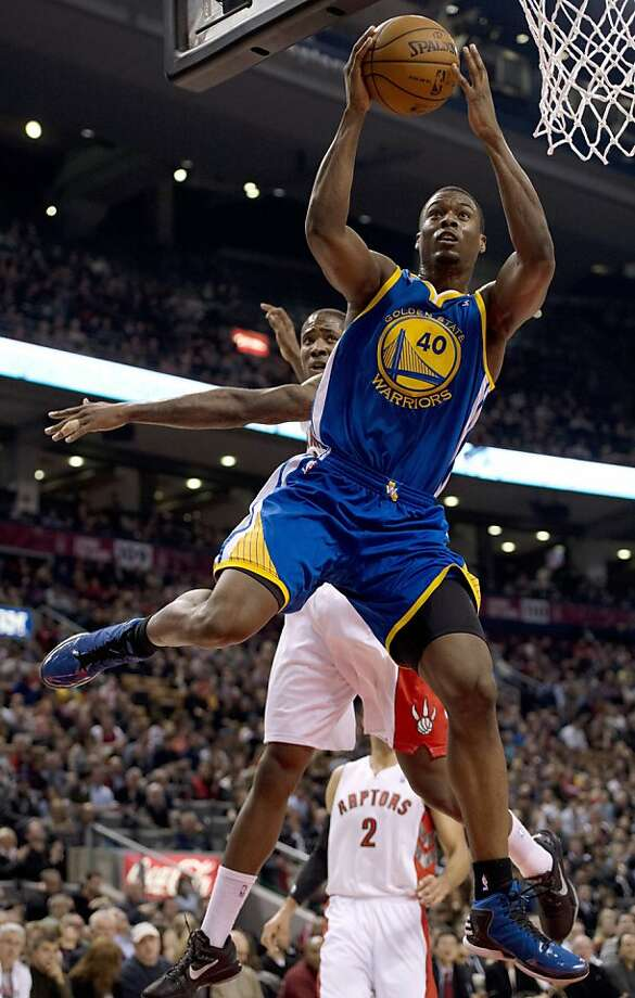 Golden State Warriors forward Harrison Barnes (40) drives to the basket ahead of Toronto Raptors forward Ed Davis during the first half of their NBA basketball game, Monday, Jan. 28, 2013, in Toronto. (AP Photo/The Canadian Press, Frank Gunn) Photo: Frank Gunn, Associated Press