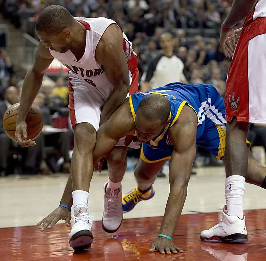 Golden State Warriors forward Carl Landry, right, battles for a loose ball with Toronto Raptors guard Alan Anderson, left, during second half NBA action in Toronto on Monday Jan. 28, 2013. (AP Photo/The Canadian Press, Frank Gunn) Photo: Frank Gunn, Associated Press