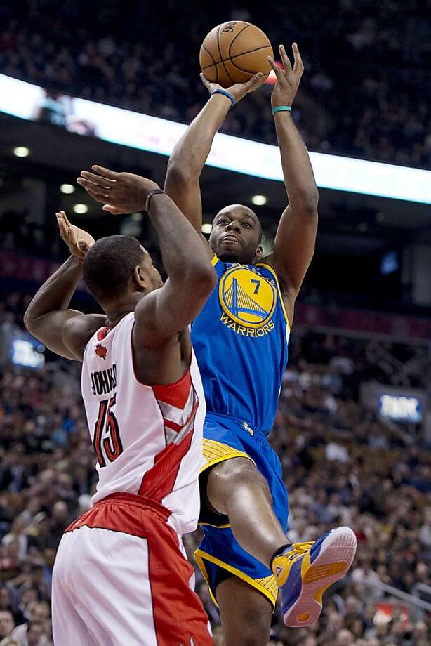 Golden State Warriors forward Carl Landry (7) shoots over Toronto Raptors forward Amir Johnson during the first half of their NBA basketball game, Monday, Jan. 28, 2013, in Toronto. (AP Photo/The Canadian Press, Frank Gunn) Photo: Frank Gunn, Associated Press