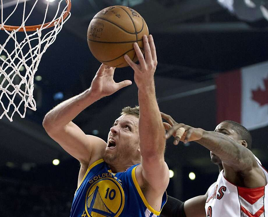 Golden State Warriors forward David Lee (10t) is fouled by Toronto Raptors forward Ed Davis during the first half of their NBA basketball game, Monday, Jan. 28, 2013, in Toronto. (AP Photo/The Canadian Press, Frank Gunn) Photo: Frank Gunn, Associated Press