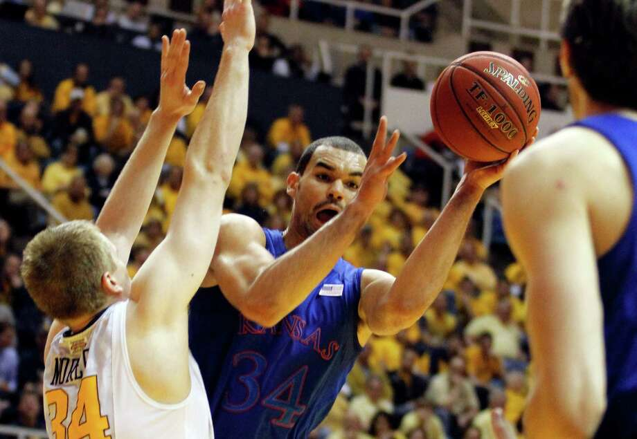 Perry Ellis #34 of the Kansas Jayhawks looks to pass against the West Virginia Mountaineers at the WVU Coliseum on January 28, 2013 in Morgantown, West Virginia. Photo: Justin K. Aller, Getty Images / 2013 Getty Images