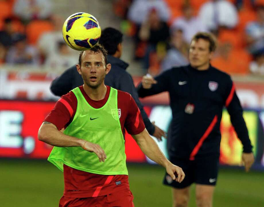 Dynamo midfielder Brad Davis concentrates on earning a chance to help the U.S. men's team reach Brazil in 2014. Photo: Johnny Hanson, Staff / © 2013  Houston Chronicle