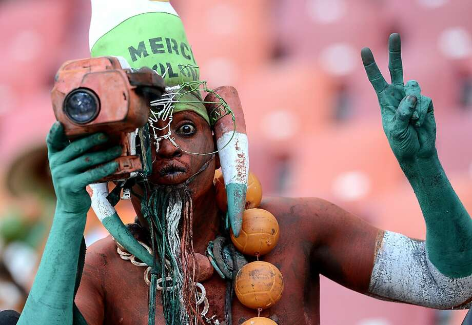 TOPSHOTS A Niger's Supporter poses with a camera prior a 2013 Africa Cup of Nations football match against Ghana at Nelson Mandela Bay Stadium in Port Elizabeth on January 28, 2013. AFP PHOTO / STEPHANE DE SAKUTINSTEPHANE DE SAKUTIN/AFP/Getty Images Photo: Stephane De Sakutin, AFP/Getty Images
