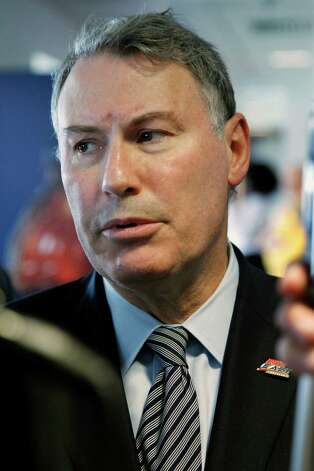 In this photo taken Saturday, Oct. 6, 2012, Big East Commissioner Mike Aresco listens to a question during an NCAA college football game between Connecticut and Rutgers in Piscataway, N.J. Aresco has to be smiling heading toward the midpoint of the football season. He has three ranked teams, and they're all unbeaten. (AP Photo/Mel Evans) Photo: Mel Evans, Associated Press / AP