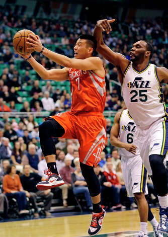 Jan. 28: Rockets 125, Jazz 80Rockets guard Jeremy Lin drives to the basket against Al Jefferson of the Jazz. Photo: Rick Bowmer