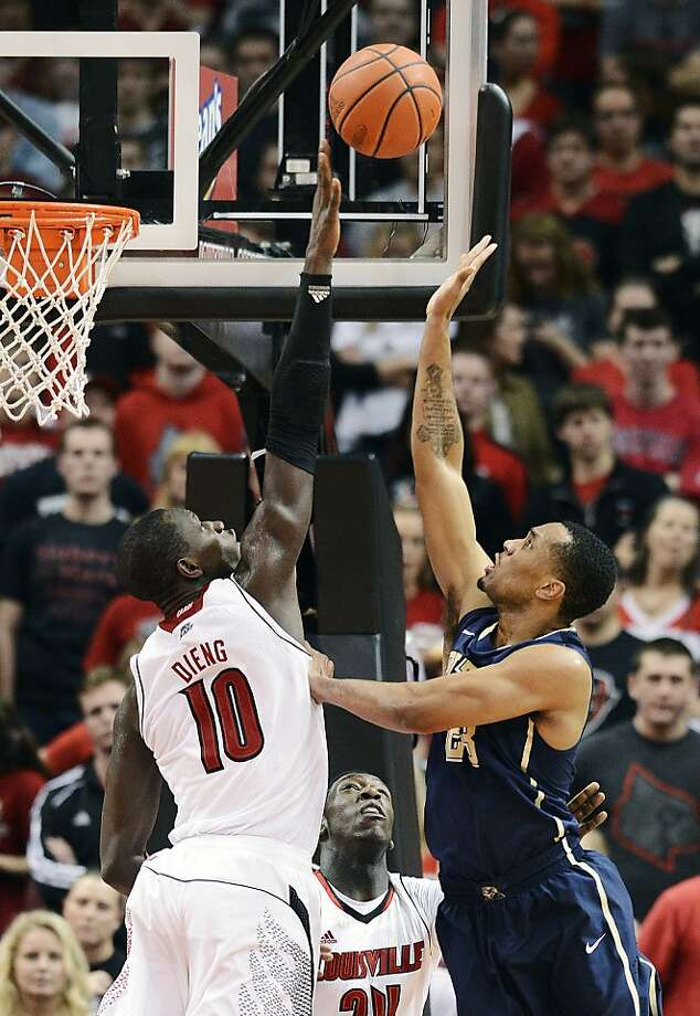 Louisville's Gorgui Dieng goes up to block the shot of Pitt's Trey Zeigler in the second half. Photo: Timothy D. Easley, Associated Press