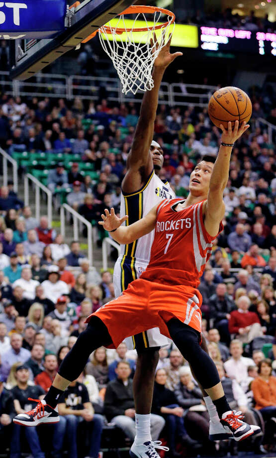 Jeremy Lin of the Rockets shoots over Paul Millsap of the Jazz. Photo: Rick Bowmer