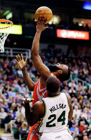 Rockets shooting guard James Harden shoots while Jazz forward Paul Millsap defends. Photo: Rick Bowmer