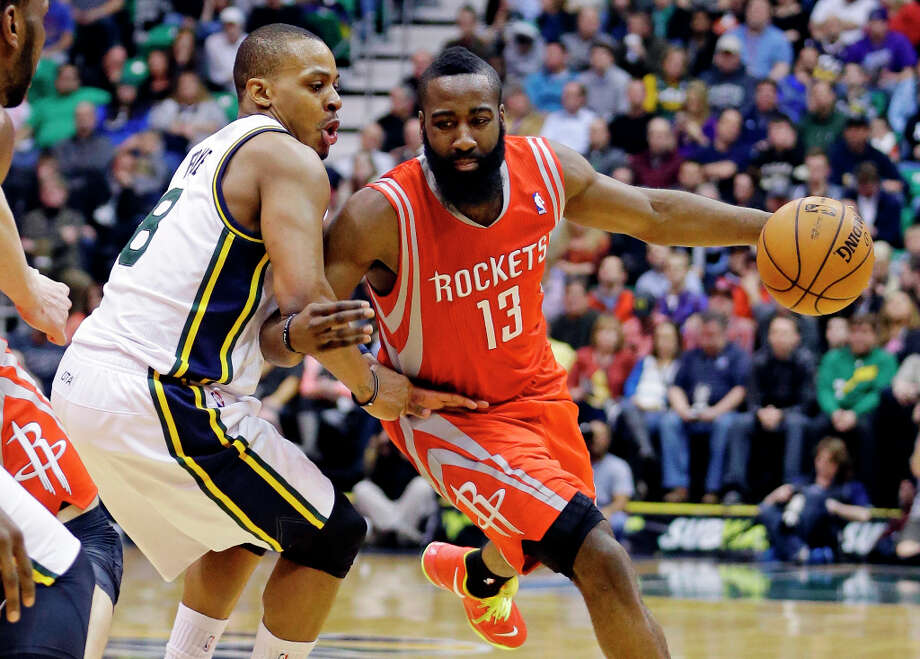Rockets guard James Harden tries to drive around Jazz guard Randy Foye. Photo: Rick Bowmer