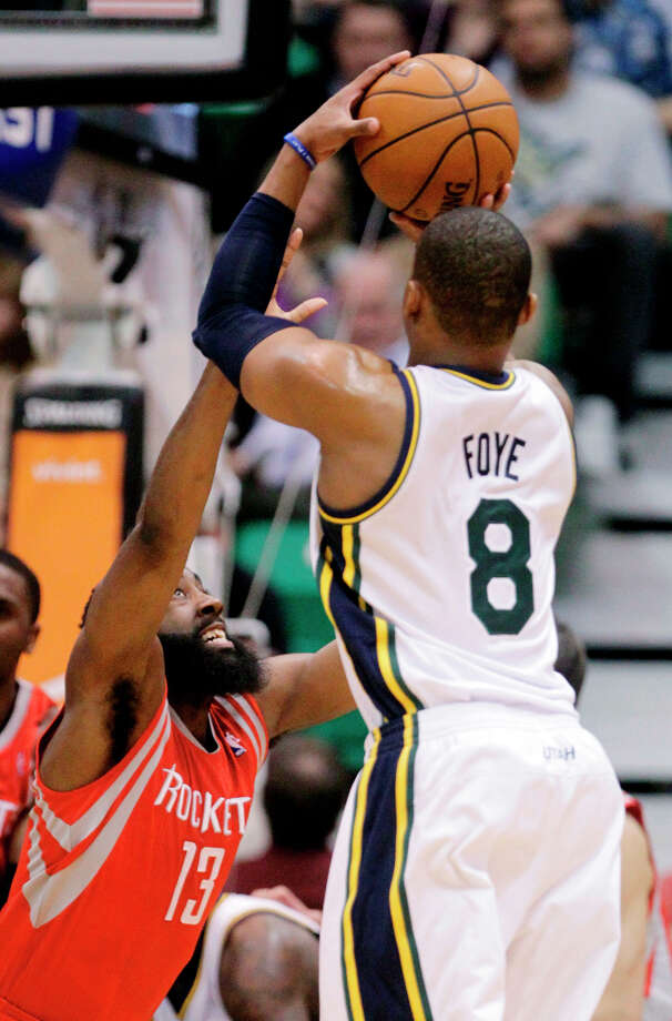 Utah guard Randy Foye attempts a jump shot over James Harden of the Rockets. Photo: Rick Bowmer