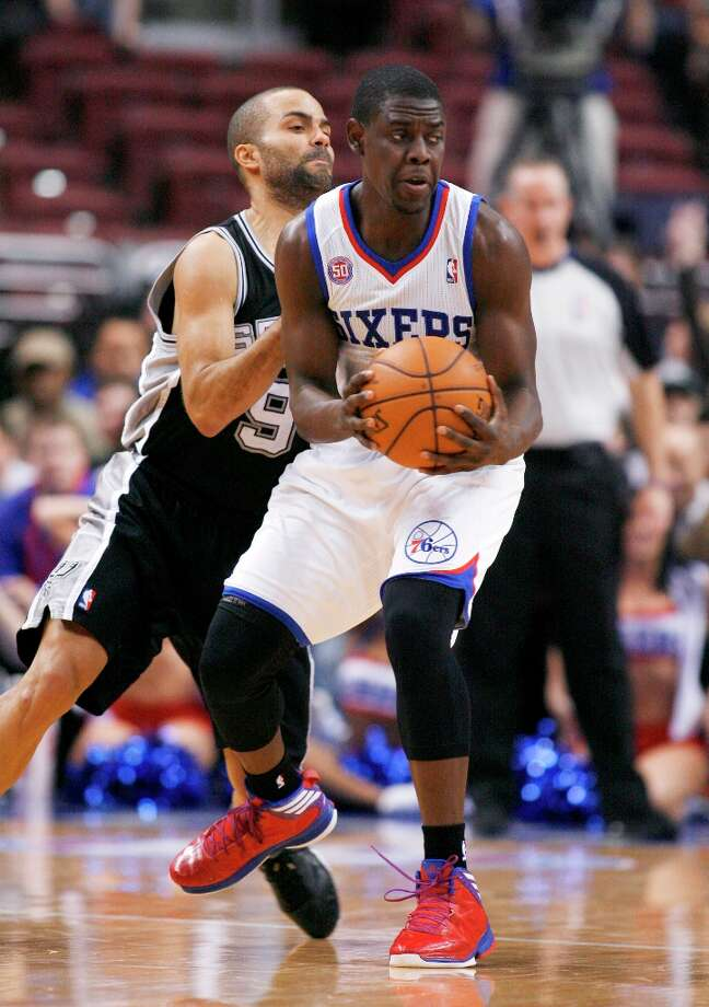 The Spurs' Tony Parker (9) defends as Philadelphia 76ers' Jrue Holiday looks to pass in the first half Monday Jan. 21, 2013, in Philadelphia. The Spurs won 90-85. Photo: H. RUMPH JR, Associated Press / FR61717 AP