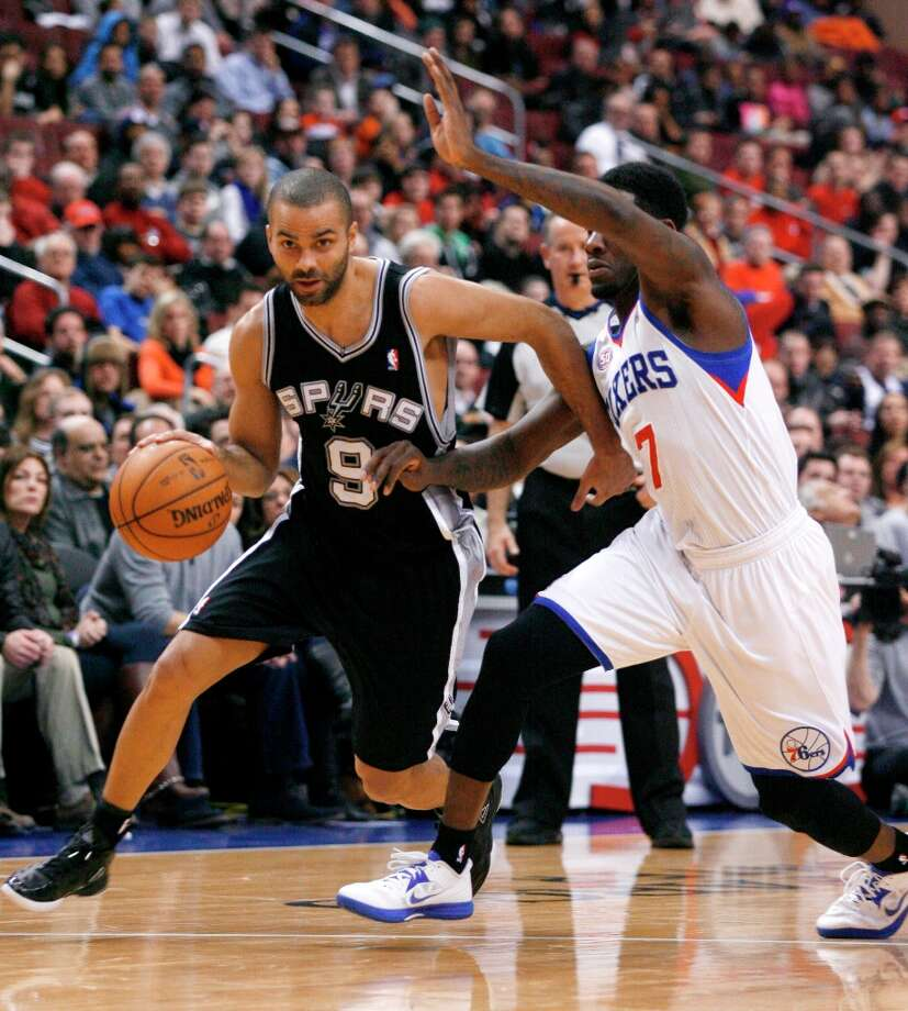 The Spurs' Tony Parker (9) drives against Philadelphia 76ers' Royal Ivey (7) in the second half Monday Jan. 21, 201,3 in Philadelphia.  The Spurs won 90-85. Photo: H. Rumph Jr., Associated Press / FR61717 AP