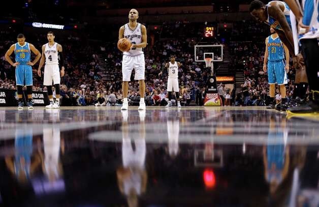 The Spurs' Tony Parker (9) shoots a free throw during the second half against the New Orleans Hornets, Wednesday, Jan. 23, 2013, in San Antonio. Photo: Eric Gay, Associated Press / AP