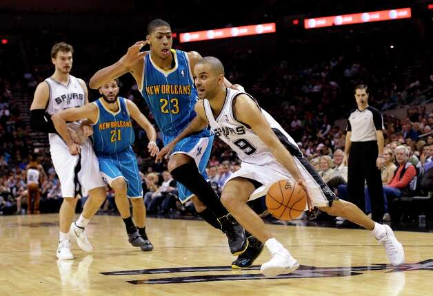 The Spurs' Tony Parker (9) drives around New Orleans Hornets' Anthony Davis (23) during the second half, Wednesday, Jan. 23, 2013, in San Antonio. Photo: Eric Gay, Associated Press / AP
