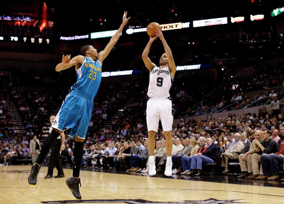 The Spurs' Tony Parker (9) shoots over New Orleans Hornets' Anthony Davis (23) during the second half, Wednesday, Jan. 23, 2013, in San Antonio. Photo: Eric Gay, Associated Press / AP