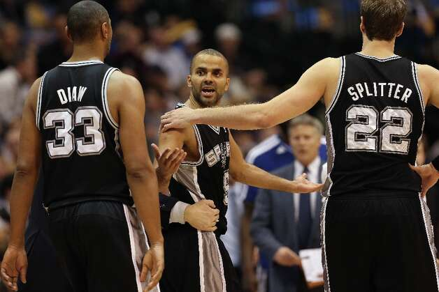 Tony Parker (9) of the Spurs reacts after getting hit in the eye against the Dallas Mavericks at American Airlines Center on Jan. 25, 2013 in Dallas. Photo: Ronald Martinez, Getty Images / 2013 Getty Images