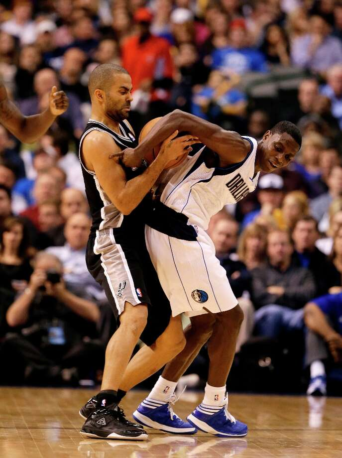 The Spurs' Tony Parker (9) attempts to steal the ball away from Dallas Mavericks' Darren Collison (4) in the second half Friday, Jan. 25, 2013, in Dallas. Collison was able to retain control of the ball in the 113-107 Mavericks loss. Photo: Tony Gutierrez, Associated Press / AP