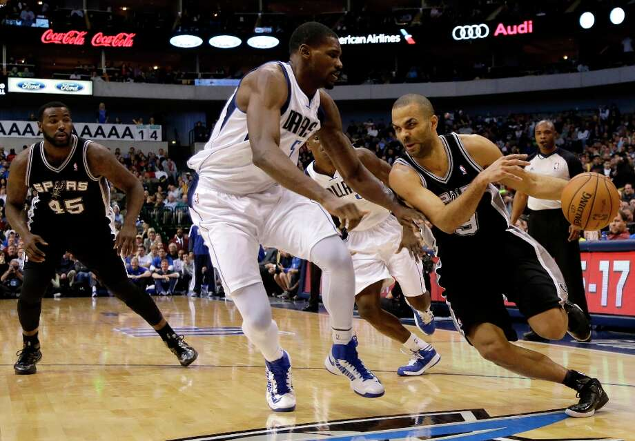 The Spurs' DeJuan Blair (45) watches as Tony Parker (9) attempts to get past Dallas Mavericks' Bernard James (5) in the second half Friday, Jan. 25, 2013, in Dallas. The Spurs won 113-107. Photo: Tony Gutierrez, Associated Press / AP