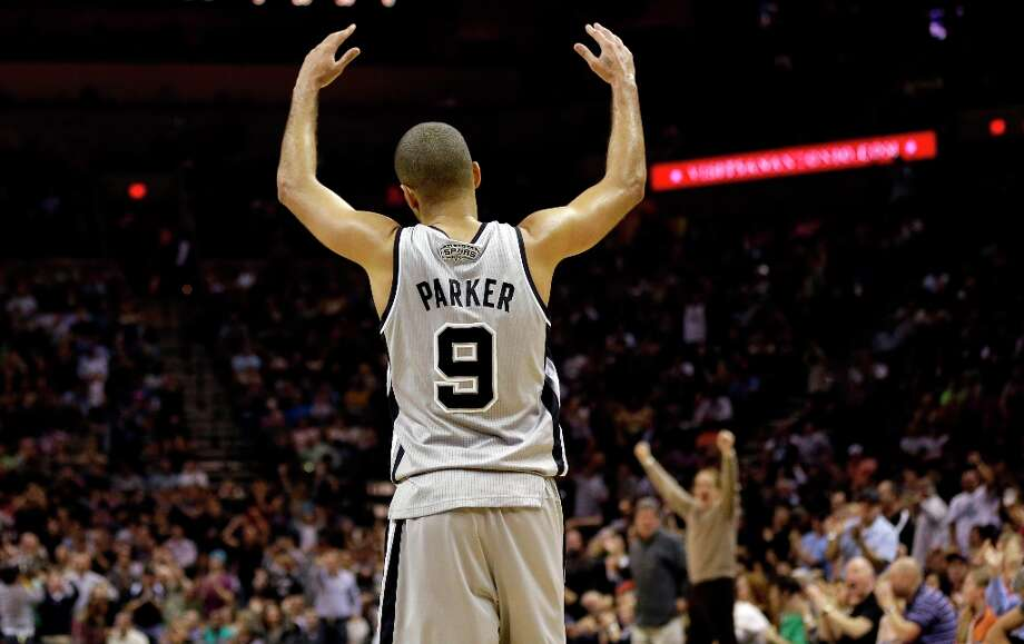 The Spurs' Tony Parker reacts to fans during the third quarter against the Phoenix Suns, Saturday, Jan. 26, 2013, in San Antonio. San Antonio won 108-99. Photo: Eric Gay, Associated Press / AP