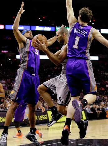 The Spurs' Tony Parker (center) is caught between Phoenix Suns defenders Jared Dudley (3) and Goran Dragic (1) during the first quarter, Saturday, Jan. 26, 2013, in San Antonio. Photo: Eric Gay, Associated Press / AP
