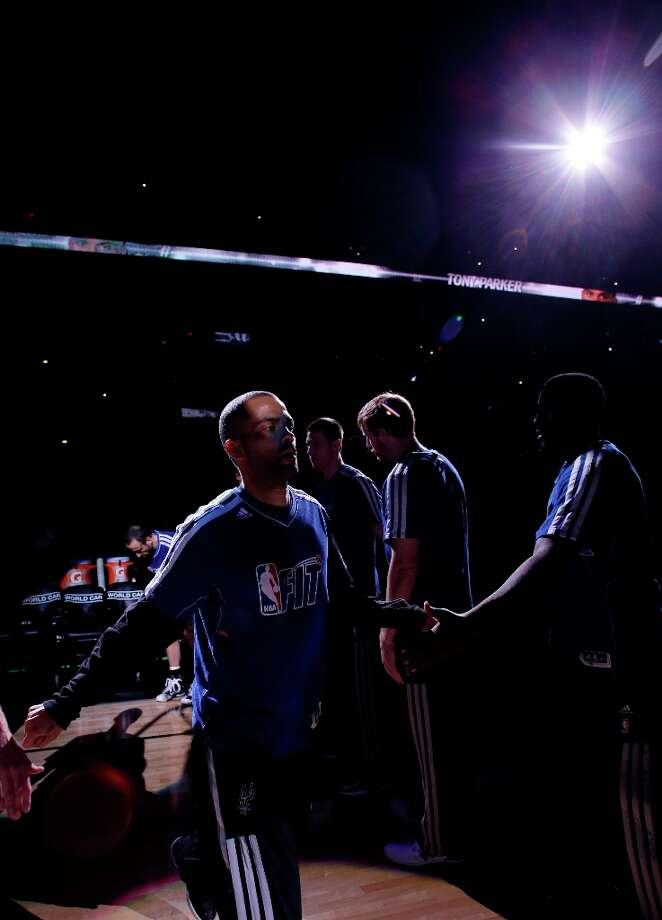The Spurs' Tony Parker (left)  is introduced during an NBA basketball game against the Phoenix Suns, Saturday, Jan. 26, 2013, in San Antonio. Photo: Eric Gay, Associated Press / AP