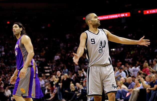 The Spurs' Tony Parker (9)  reacts after as play as Phoenix Suns' Luis Scola   walks past during the fourth quarter, Saturday, Jan. 26, 2013, in San Antonio. San Antonio won 108-99. Photo: Eric Gay, Associated Press / AP