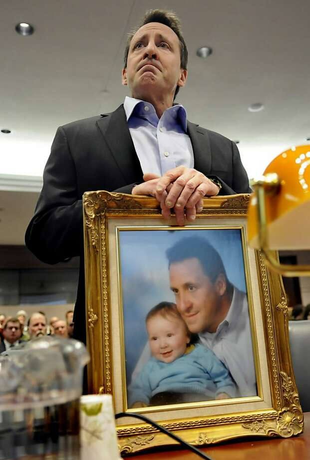 "Neil Heslin holds a framed photograph of himself taken with his son Jesse, whom was a baby at the time, while appearing at a hearing of the legislature's Bipartisan Task Force On Gun Violence Prevention and Children's Safety at the legislative office building in Hartford, Connecticut, Monday, January 28, 2013. Jesse, 6, was one of the twenty children killed in the Sandy Hook massacre.  ""Jesse was my buddy and my best friend,"" Heslin said. (Cloe Poisson/Hartford Courant/MCT) Photo: Cloe Poisson, McClatchy-Tribune News Service"