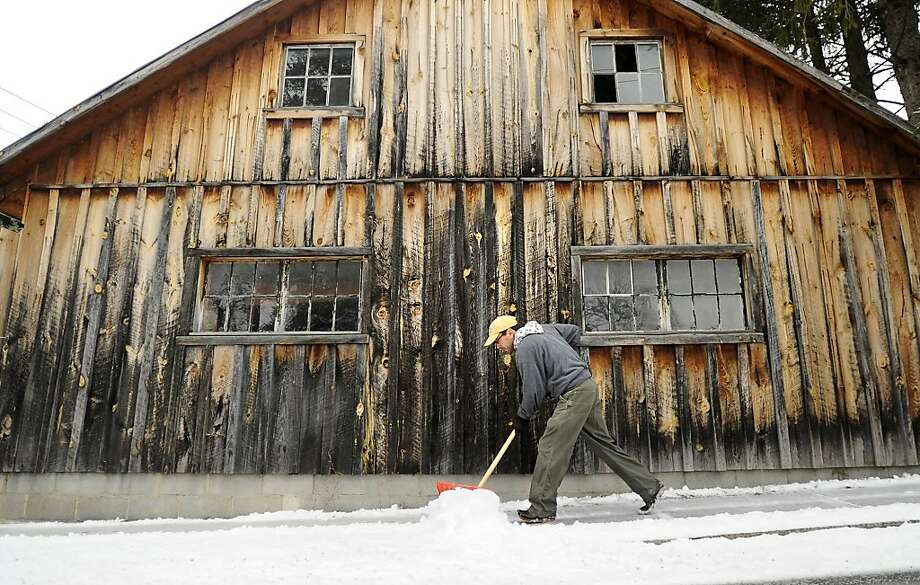Ken Hull shovels snow from his sidewalk along Academy  Street, in Boalsburg, Pa., Monday Jan. 28, 2013.  A combination of snow, sleet, and rain, in Centre County Monday  caused all school to be closed.    (AP Photo/Centre Daily Times,Nabil K. Mark ) MANDATORY CREDIT; MAGS OUT Photo: Nabil K. Mark, Associated Press