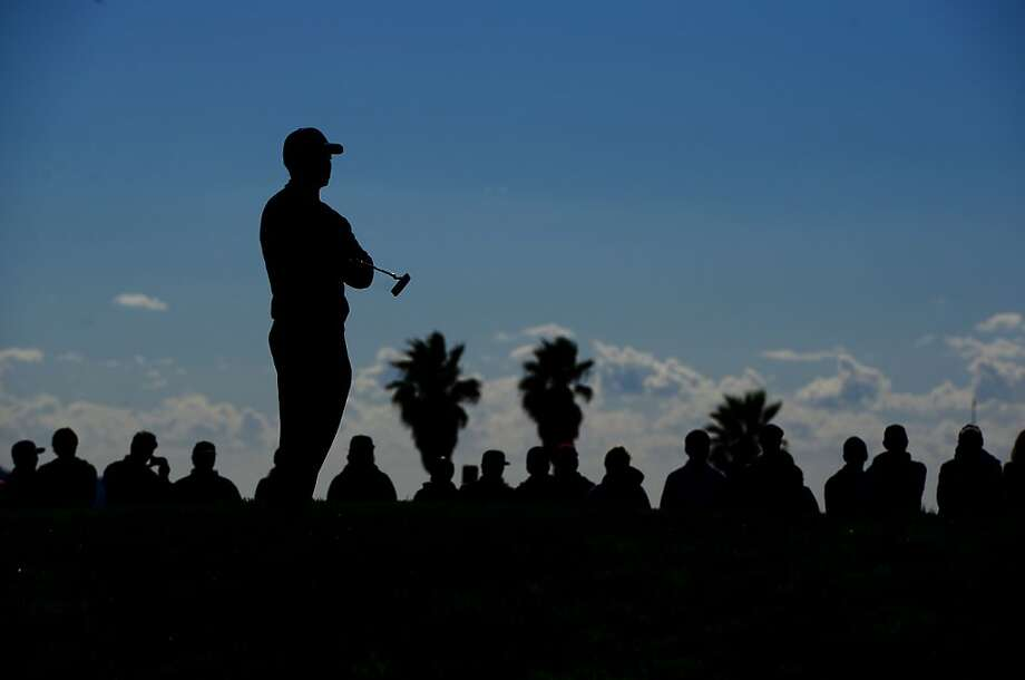 LA JOLLA, CA - JANUARY 28:  Tiger Woods looks on from the 12th green en route to his -14 under victory during the Final Round at the Farmers Insurance Open at Torrey Pines Golf Course on January 28, 2013 in La Jolla, California. (Photo by Donald Miralle/Getty Images) Photo: Donald Miralle, Getty Images