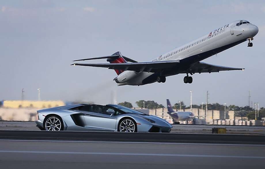 MIAMI, FL - JANUARY 28:  A new Lamborghini Aventador LP700-4 Roadsters is seen as it is driven along the south runway at the Miami International Airporton January 28, 2013 in Miami, Florida. The world wide unveiling of the new luxury super sports cars took place at the airport.  (Photo by Joe Raedle/Getty Images) Photo: Joe Raedle, Getty Images