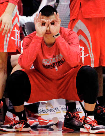 Rockets point guard Jeremy Lin reacts to a made 3-pointer in the fourth quarter. Photo: Rick Bowmer