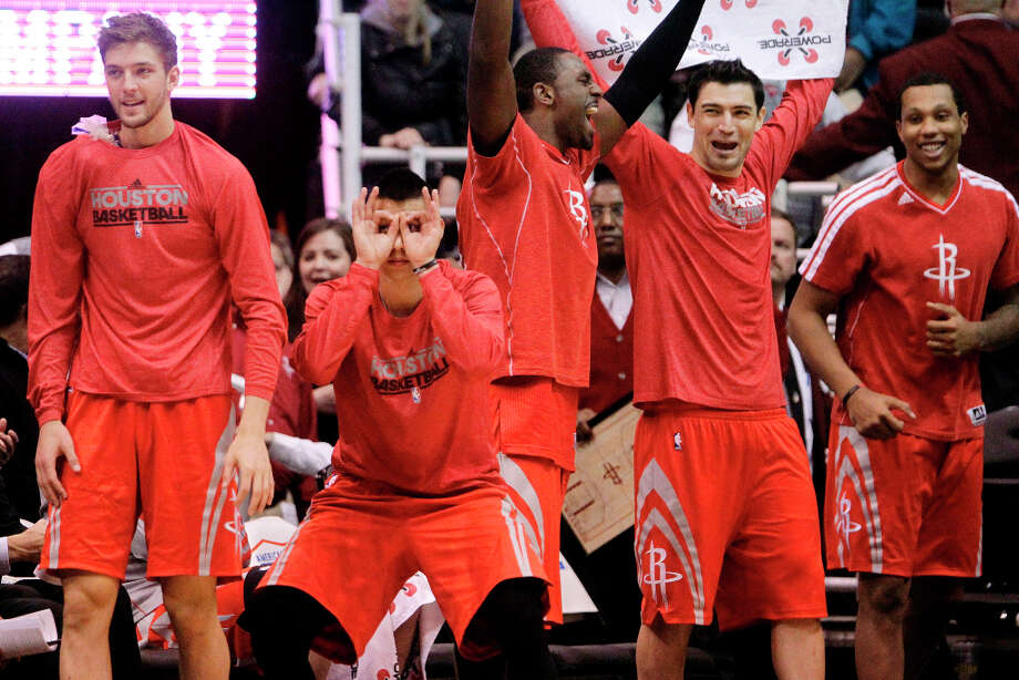 From left, Houston Rockets' Chandler Parsons, Jeremy Lin, Patrick Patterson, Carlos Delfino and Greg Smith celebrate a teammate's 3-pointer against the Jazz in the fourth quarter. Photo: Rick Bowmer