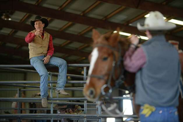 "Lanny Leach advises Ben Thamer about how to mount a mustang in Cresson, Texas, on Wednesday, Jan. 23, 2013. Leach is advising a group that will be riding mustangs for a ride from the Arizona-Mexico border to Canada. The group will produce a documentary about their ride, called ""Unbranded."" The project is being funded through the Kickstarter website. Photo: Billy Calzada, San Antonio Express-News / SAN ANTONIO EXPRESS-NEWS"