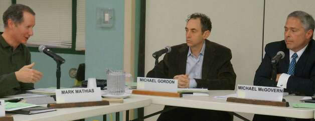 Board of Education members, from left, Mark Mathias, Secretary Michael Gordon and Vice Chairman Michael McGovern discuss class sizes and their impact on the budget during MOnday's meeting.  WESTPORT NEWS, CT 1/28/13 Photo: Paul Schott / Westport News