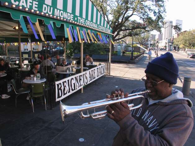 DO: Go to Cafe du Monde for beignets, mostly to say you did, but go in the afternoon when the crowds are smaller. Photo: Spud Hilton, The Chronicle / The Chronicle
