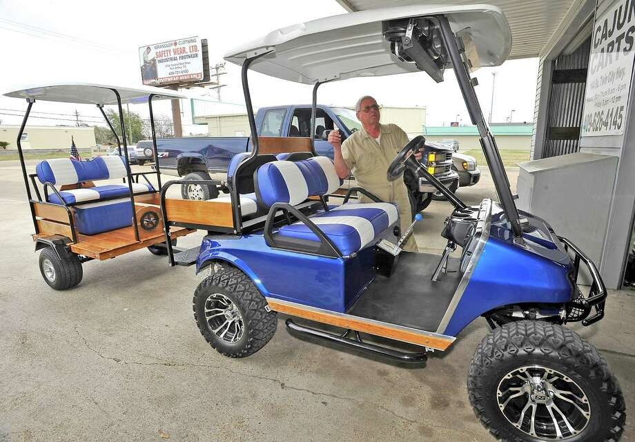 George Murray, a Nederland resident owns this tricked out 2004 Club Car DS. He even pulls a custom made trailer behind it. The seats are color matched to the body paint as well as the trailer. Seen above his head is the two speaker stereo system that can be remote controlled.  The culture of golf carts. People love to drive them in places other then just golf courses. Many people actually know you have to have a driver's license to operate it, but, do they know about all the laws pertaining to the golf carts, for instance, you could get a DWI while driving one.  Dave Ryan/The Enterprise Photo: Dave Ryan