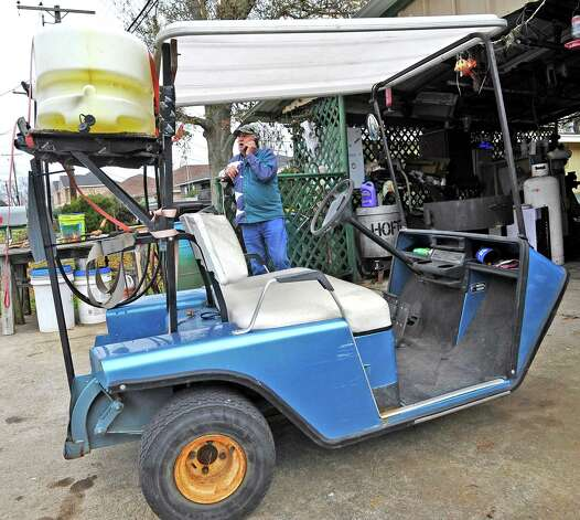 Richard Hoffpauir, a Nederland resident, has his golf cart decked out with a weed fighting pump sprayer with a tank.  His 1985 E-Z-Go is a version that has only three wheels instead of the four.The culture of golf carts. People love to drive them in places other then just golf courses. Many people actually know you have to have a driver's license to operate it, but, do they know about all the laws pertaining to the golf carts, for instance, you could get a DWI while driving one.  Dave Ryan/The Enterprise Photo: Dave Ryan
