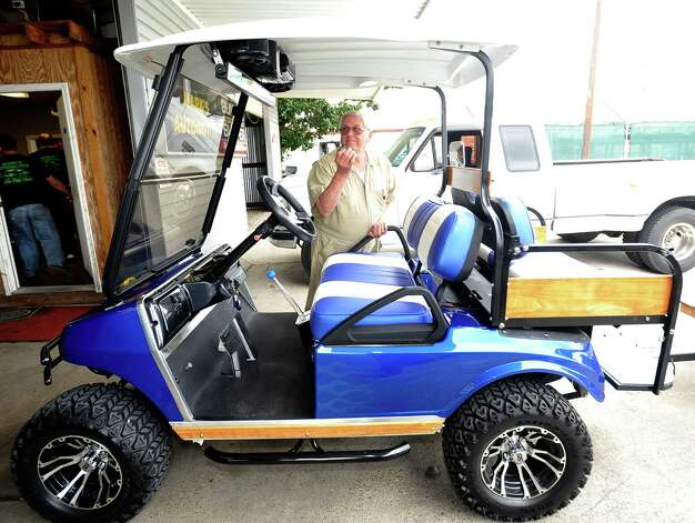 George Murray, a Nederland resident owns this tricked out 2004 Club Car DS. He even pulls a custom made trailer behind it. The seats are color matched to the body paint as well as the trailer. Seen above his head is the two speaker stereo system that can be remote controlled.  The culture of golf carts. People love to drive them in places other then just golf courses. Many people actually know you have to have a driver's license to operate it, but, do they know about all the laws pertaining to the golf carts, for instance, you could get a DWI while driving one.  Dave Ryan/The Enterprise