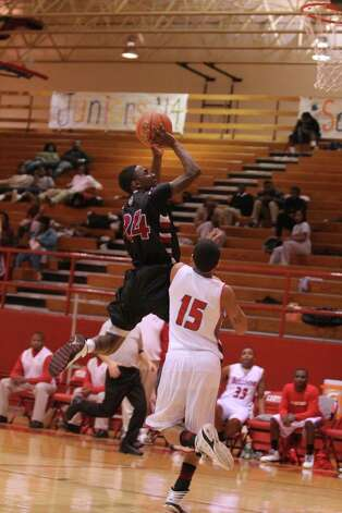 Devonte Johnson puts up a short shot against Carthage. Photo: Jason Dunn