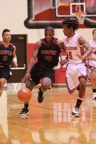 Jarrell Armstrong brings the ball upcourt against Carthage. Photo: Jason Dunn